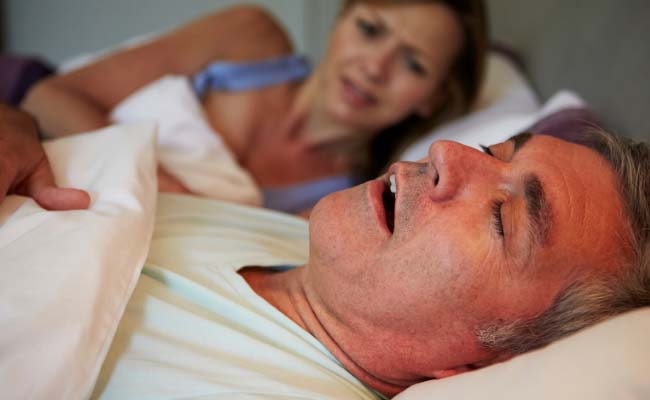 Snoring man keeping a woman awake