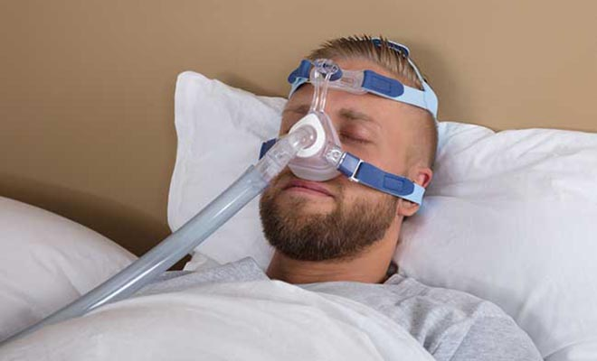 Man using CPAP machine